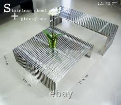 Bauhaus stainless steel bench with acrylic distance pieces. Length 140 cm